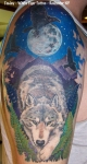 Wolf with Moon tattoo