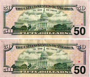 marked Fifty dollar bills
