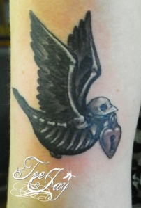 Skeleton Sparrow with locket tattoo