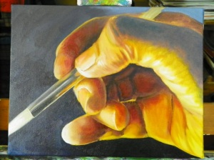 oil painting hand with paintbrush