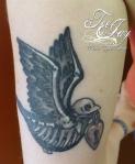 dead traditional bird tattoo