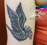 skeleton traditional bird tattoo