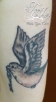 song sparrow tattoo with key