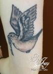 black and grey traditional bird tattoo
