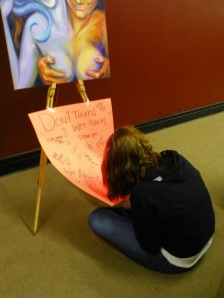 Jess making wet paint sign