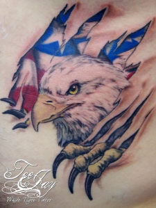 tattoo eagle tearing out of skin with flag