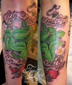 family wealth strawberry tattoo