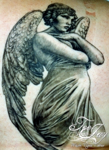 angel sculpture tattoo