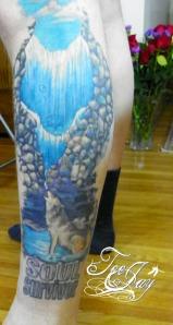 Wolf waterfall tattoo