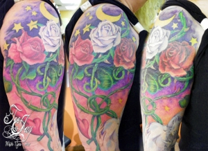 Woman tattoo sleeve - stars roses and love