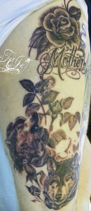 wolf rose vine tattoo