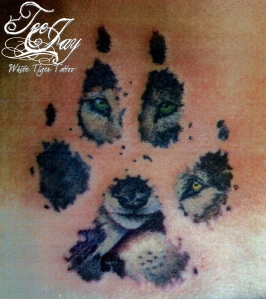 wolves inside pawprint tattoo