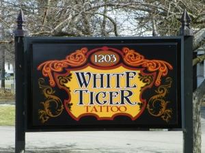 White Tiger Tattoo Webster sign