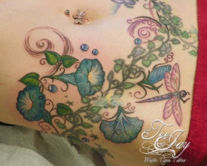 tattoo of morning glories and dragonfly