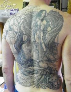 black and grey back tattoo
