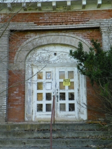 door of abandoned high school