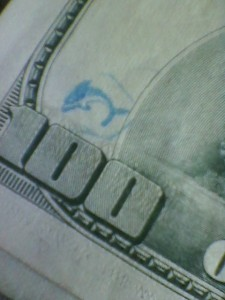 blue dolphin stamp on $100