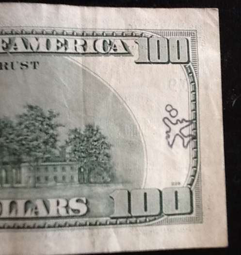 airplane stamp on $100 bill