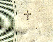 small cross stamp on currency