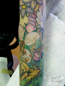 flowers and ring tailed woozle tattoo