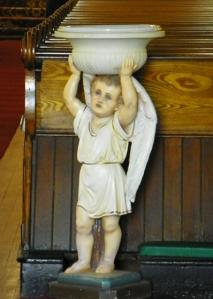 cherub holding up Holy Water