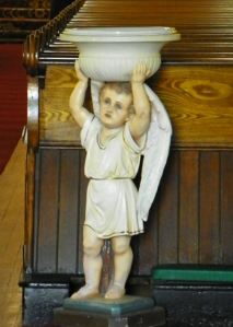 cherub holding up Holy Water