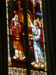 stained glass of Moses receiving Commandments