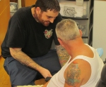 Joe Caiazza tattooing