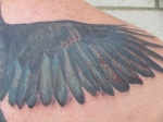 crow tattoo wing detail bloody