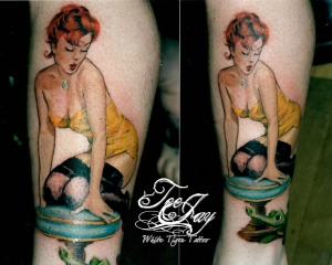 Pin-up with wind up alligator tattoo