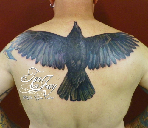 Full color crow tattoo