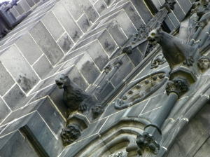 close up side of cathedral with gargoyles