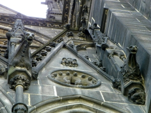 dudes and gargoyles on side of cathedral