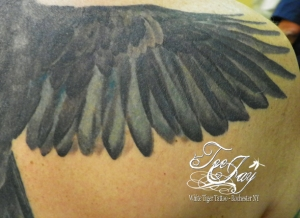 crow tattoo wing detail