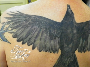 crow tattoo detail