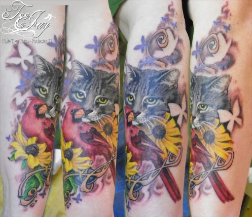 tattoo of cat and cardinal