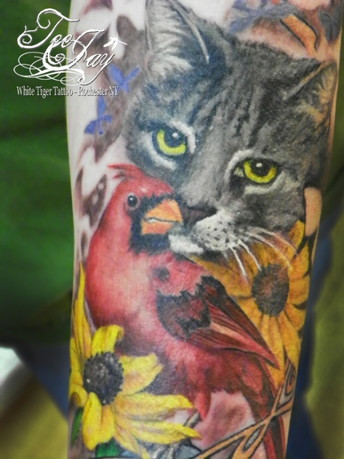 tattoo of cat and cardinal