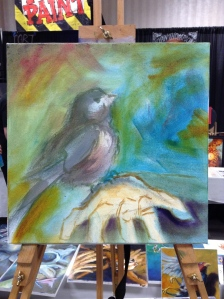 wip oil painting bird on hand