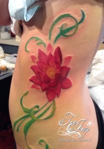 lotus ribs tattoo