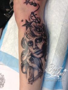 sugar skull memorial tattoo
