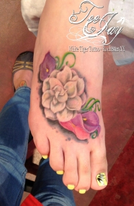 foot flowers tattoo