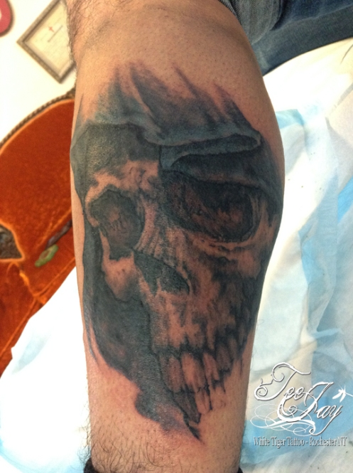 Shirley tattoo cover-up with skull