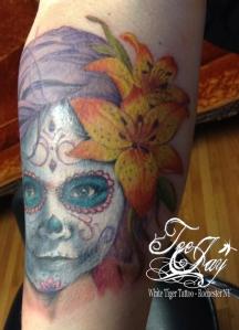 sugar skull tattoo of daughter