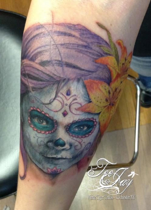 Portrait tattoo of daughter as sugar skull