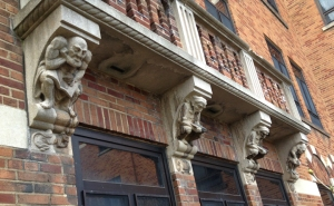 row of reading gargoyles