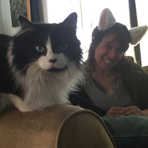TeeJay in ears with cat