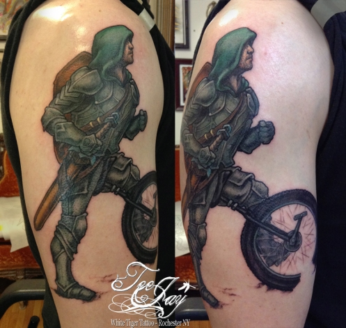 mountain unicycle knight tattoo