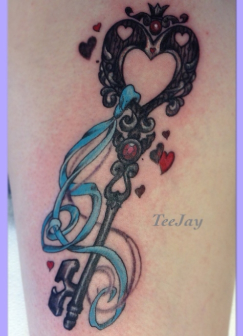 ornate key tattoo