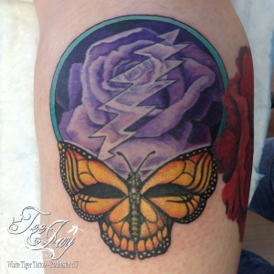 rose and butterfly steal your face tattoo