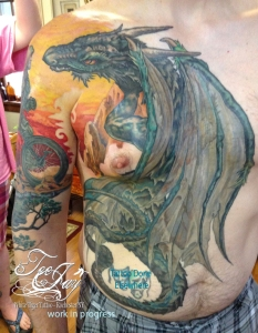dragon facing off mountain unicyle riding knight tattoo